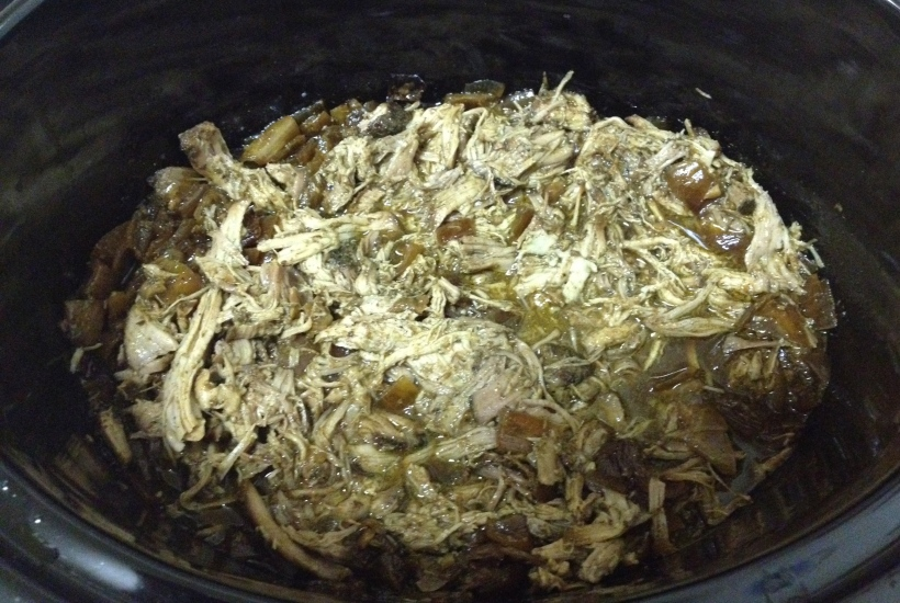 Throw all that lovely pulled pork back into your slow cooker and mix it around.